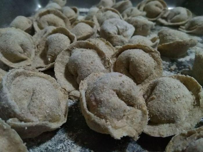 Close-up of garlic on rocks
