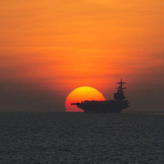 USS HW Bush sailing off into the sunset USA Us Military U.S. Navy USS HW Bush