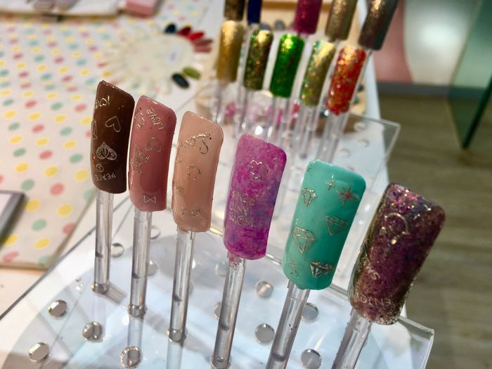 High Angle View Of Colorful Artificial Nails For Sale In Store