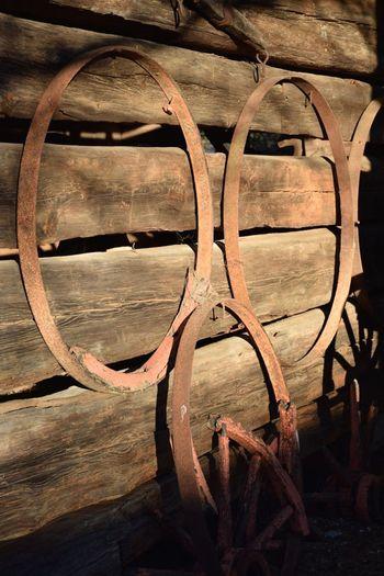 Wood Barn Wood Logs Close-up Day Gear Metal Hoops Metal Rim No People Old Barn Rusty Rusty Metal Wood - Material