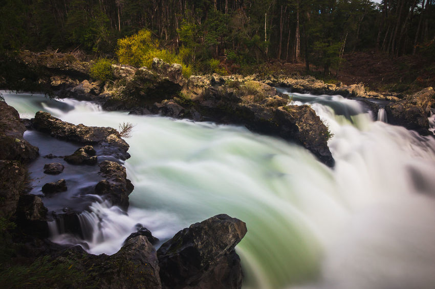 Trancura river... Aroundtheworld Beauty In Nature Blurred Motion Flowing Flowing Water Forest Land Long Exposure Motion Nature Outdoors Plant Power In Nature Rainforest River Rock Rock - Object Scenics Scenics - Nature Solid Stream - Flowing Water Travel Destinations Tree Water Waterfall