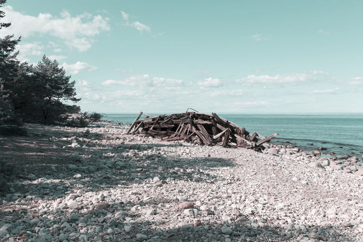 The wreck Swiks at the northern tip of Öland, Sweden Coastline Drastic Edit Sweden Water's Edge Wreck Beach Beauty In Nature Broken Cloud - Sky Damaged Day Destruction Driftwood Horizon Over Water Landscape Nature No People Outdoors Scenics Sea Sky Tranquility Water Wood - Material Öland