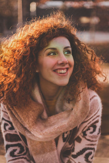 Close-Up Of Smiling Woman In Warm Clothing