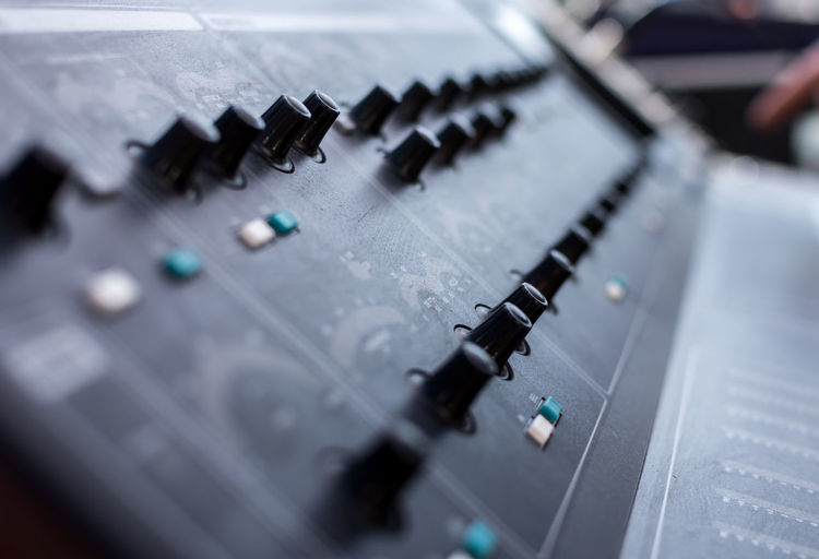 Close-up of sound console on stage