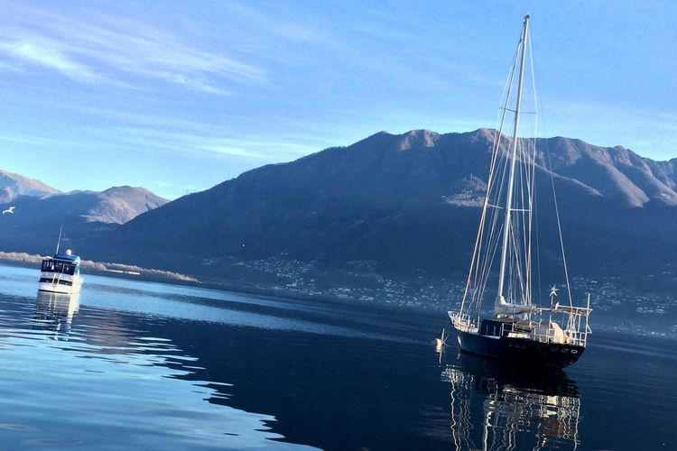 Mountain Nautical Vessel Transportation Sky Mode Of Transport Mountain Range Water Scenics Day Sea Nature Beauty In Nature Outdoors No People Mast Sailing Sailboat Boat Deck