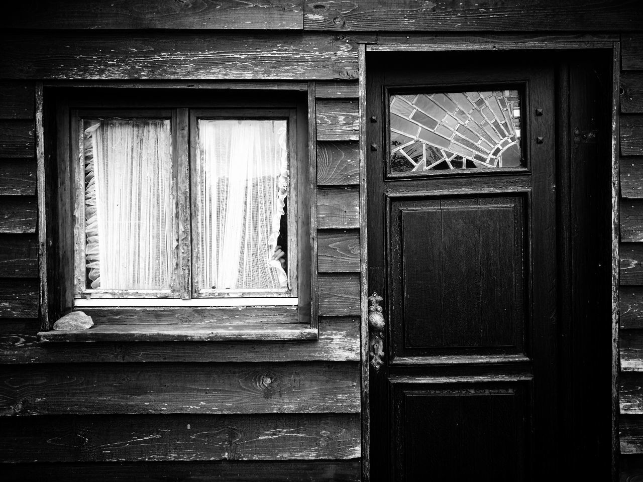 window, wood - material, architecture, building exterior, built structure, building, door, no people, house, closed, entrance, day, safety, security, protection, old, outdoors, residential district, wood, glass - material
