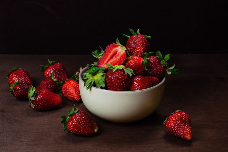 Fresh strawberries in ceramic bowl on dark wooden background. Selective focus. Food And Drink Food Freshness Red Indoors  Still Life No People Strawberry Strawberries Fruit Fruits Fresh Healthy Eating Vehetable Natural Raw Vitamin Raw Food Tasty Breakfast Ripe Juicy Sweet Berry Delicious Nutrition Background Rustic Dessert Freshness Eating Organic Close-up Diet Ingredient Vegan Snack Apperitive Pattern Dark Wooden Table Brown Texture Textured  Bowl Plate Ceramic Berry Fruit Wellbeing Black Background Studio Shot Large Group Of Objects Healthy Lifestyle
