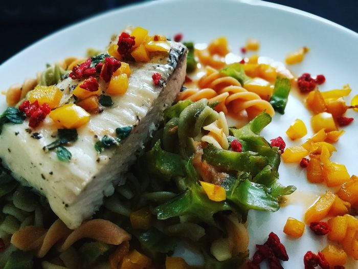 Close-Up Of Fish With Pasta In Plate