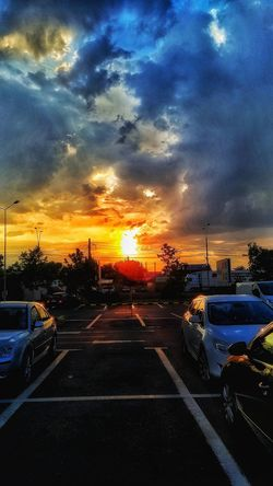 City Water Sunset Land Vehicle Road Car Dramatic Sky Traffic Dusk Storm Cloud Parking Car Roof Overcast Atmospheric Mood Moody Sky Sky Only Parking Garage Parking Lot Cumulus Weather Rainy Season Tail Light Car Point Of View Residential Structure Office Building Stationary