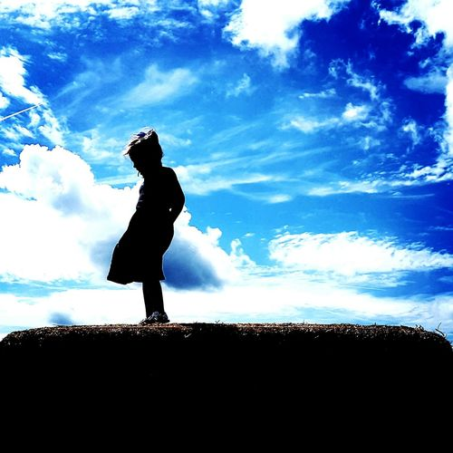 Silhouette woman standing against sky