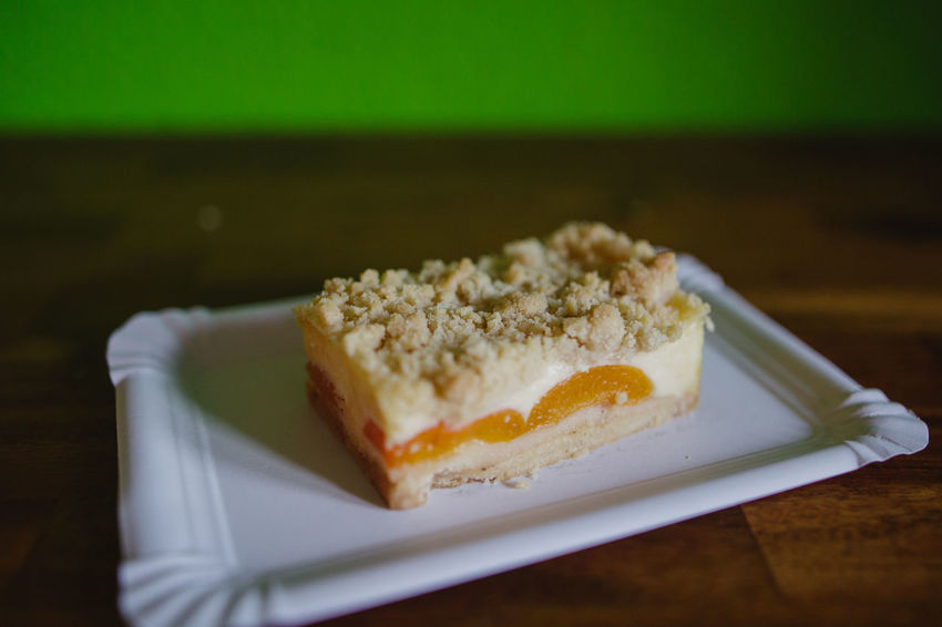 Dessert Apricot Cake Calorie Crumble Crumble Cake Food Food And Drink Freshness Green Background Paper Plate Ready-to-eat Serving Size Sweet Food Wooden
