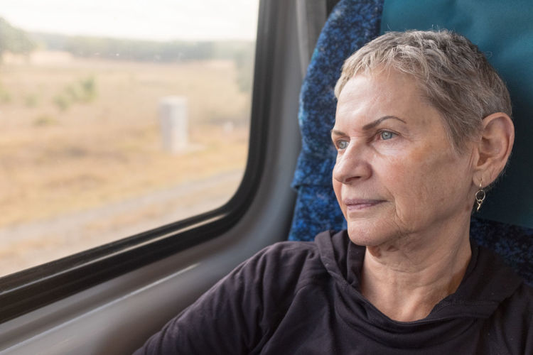 Senior woman on train Window Headshot Portrait One Person Looking Mode Of Transportation Transportation Glass - Material Adult Travel Vehicle Interior Looking Through Window Transparent Day Contemplation Looking Away Outdoors Hairstyle Train - Vehicle Senior Women Women International Women's Day 2019