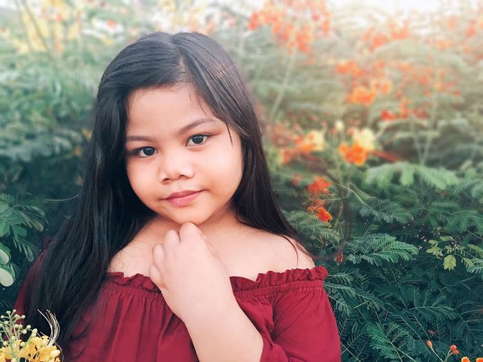 Girls Child Childhood One Girl Only Innocence Portrait Children Only One Person Looking At Camera Black Hair Cute Outdoors Real People Flower Day Human Body Part Nature People Close-up Grass Eyeem Philippines