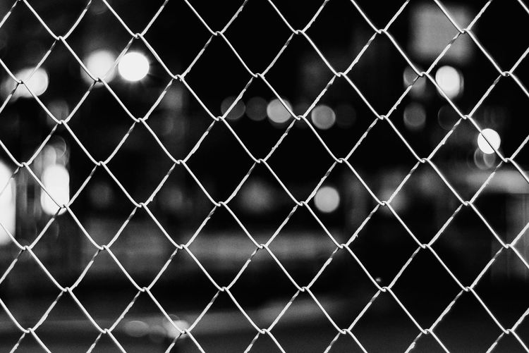 Fence Chainlink Fence Full Frame Pattern Protection Security Boundary Outdoors Focus On Foreground No People Barrier Close-up Safety Metal Sunlight Crisscross Backgrounds Day Nature Grid