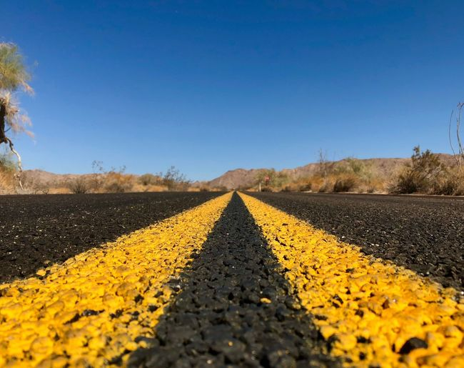 Desert Highway Distance California Travel Highway Perspective Mountains Joshua Tree National Park Desert Sky Clear Sky Yellow Direction Nature Diminishing Perspective Transportation Road Marking vanishing point Asphalt Double Yellow Line Road