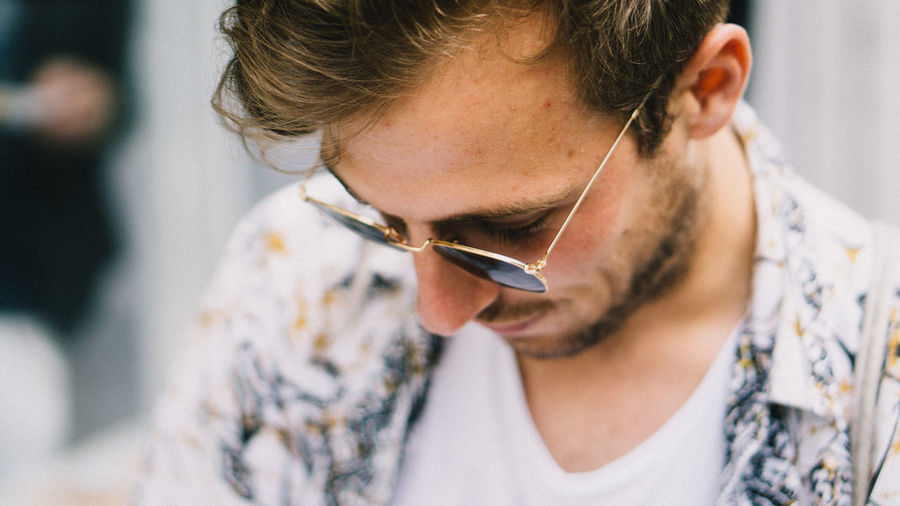 Bright Cool Adult Beard Casual Clothing Close-up Day Focus On Foreground Front View Headshot Hipster Indoors  Lifestyles Looking Looking Down Men One Person Portrait Relax Shirt Summer Sunglasses Young Adult Young Men