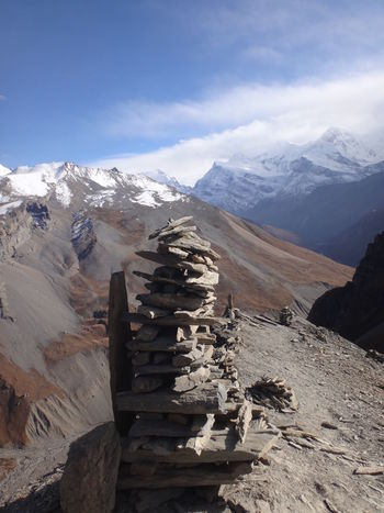 Annapurna Nepal Balance Beauty In Nature Cloud - Sky Cold Temperature Day Environment Idyllic Landscape Mountain Mountain Peak Mountain Range Nature No People Non-urban Scene Rock Balance Scenics - Nature Sky Snow Snowcapped Mountain Tranquil Scene Tranquility Winter Wood - Material