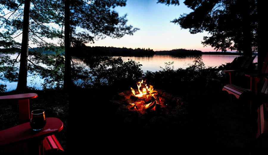 End of the day at the lake Summertime Beauty In Nature Bonfire Burning Campfire Cottage Life Day Enjoy Life Flame Lake Lakeside Nature No People Outdoors Relax And Enjoy Sky Summertime Feelings Sunset Tree Warm