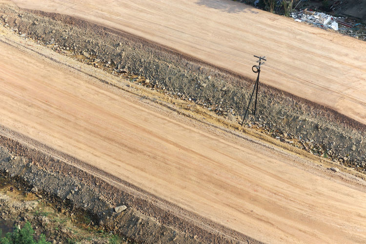 Aerial view of road under construction, laterite road or non-asphalt road in rural area