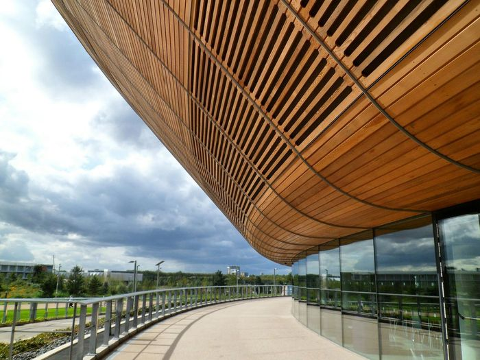 One can not help but appreciate the architecture of the London Velodrome at the Queen Elizabeth Olympic Park Structure Travel Destinations International Landmark Famous Place Capital City Outdoors Travel Capital Cities  No People Sky Clouds And Sky London Architectural Detail Olympic Park  Sports East London Velodrome