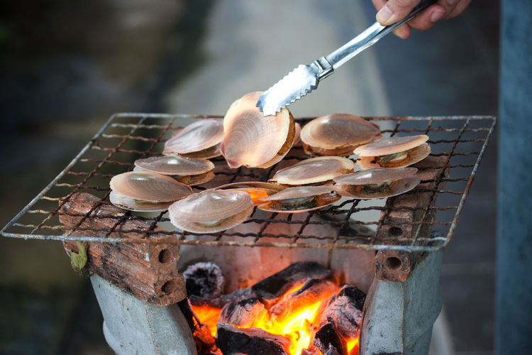 Barbecue Bonfire Burning Day Fire Fire - Natural Phenomenon Flame Focus On Foreground Food Food And Drink Freshness Hand Heat - Temperature Holding Human Hand Kitchen Utensil Nature One Person Outdoors Preparation  Preparing Food Real People