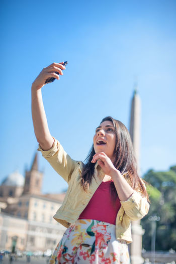 Women Taking Selfie Against Clear Blue Sky