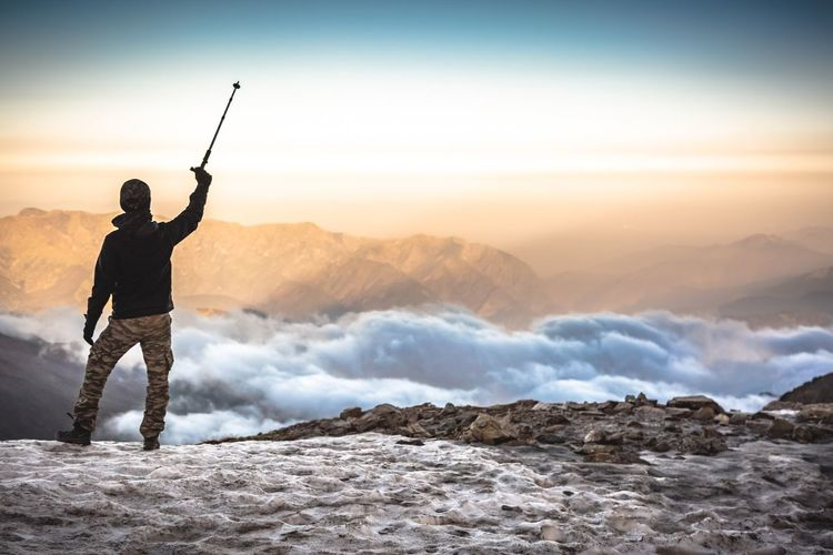 """Victory"" Roopkund Lake, Himalayas The Creative - 2018 EyeEm Awards The Traveler - 2018 EyeEm Awards The Great Outdoors - 2018 EyeEm Awards Beauty In Nature One Person Real People Mountain Scenics - Nature Leisure Activity Standing Sky Men Lifestyles Mountain Range Non-urban Scene Cold Temperature Winter Snow Nature Full Length Adventure Warm Clothing Outdoors"