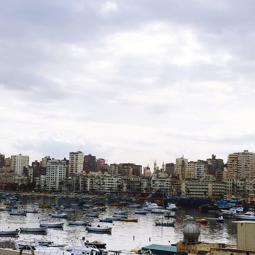 Alexandria, Egypt. Building Exterior Architecture City Built Structure Water Cityscape Sky Nautical Vessel Waterfront Outdoors Transportation Day No People Moored Residential Building Skyscraper Cloud - Sky Harbor Port Alexandria
