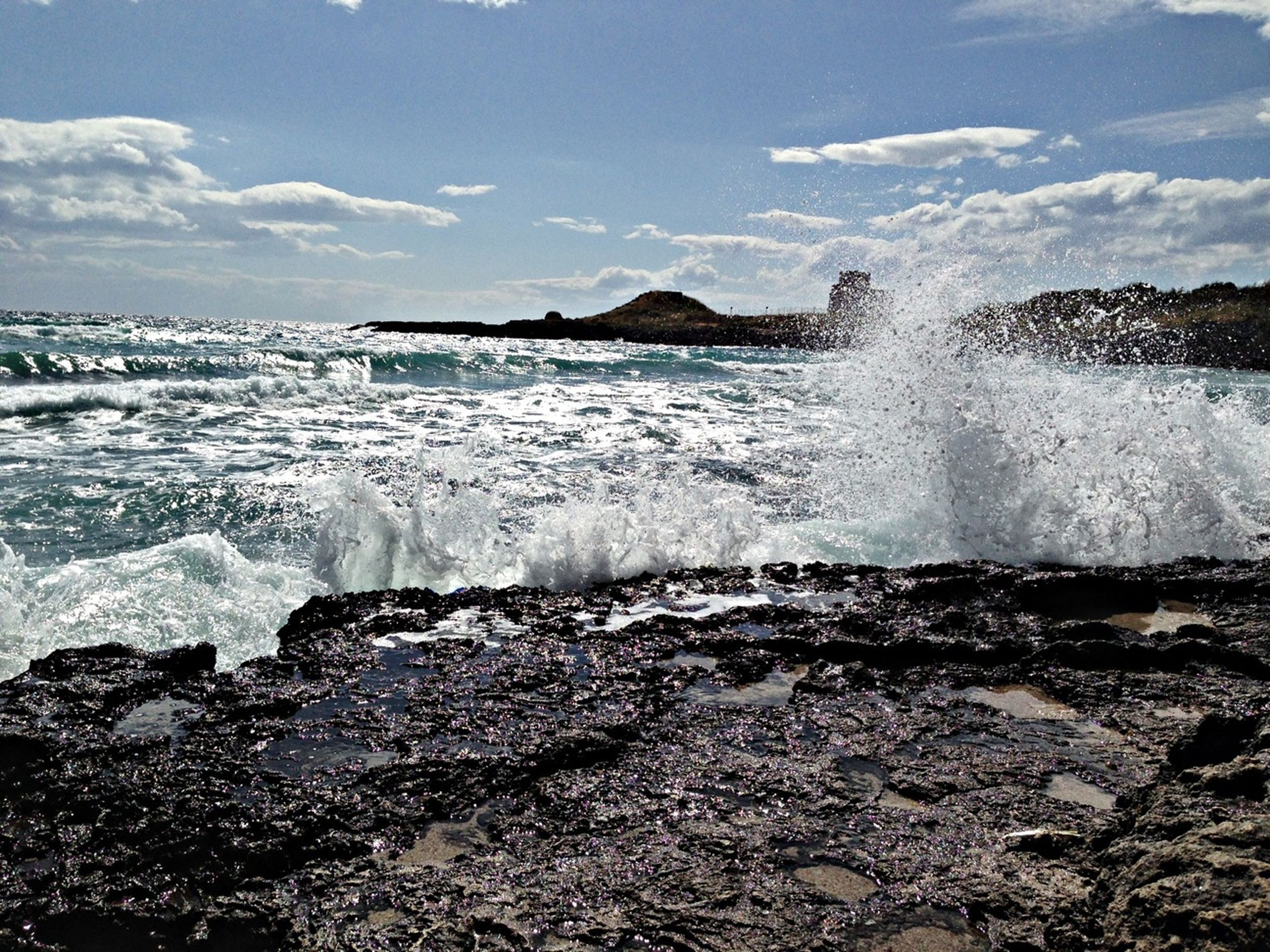 water, sea, wave, surf, motion, beach, splashing, shore, scenics, sky, beauty in nature, horizon over water, nature, rock - object, power in nature, tranquil scene, idyllic, cloud - sky, tranquility, tide