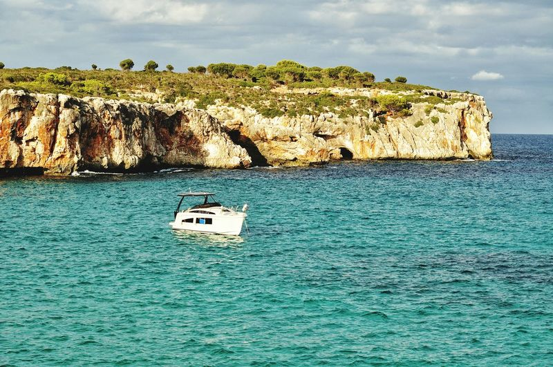 EyeEm Selects cala varques in evening light on mallorca balearic island in spain Sea Beach Rock - Object Nautical Vessel Transportation Travel Nature Scenics Travel Destinations Mediterranean  Idyllic Cala Varques Mallorca Majorca Island Cliff Sailing Yacht