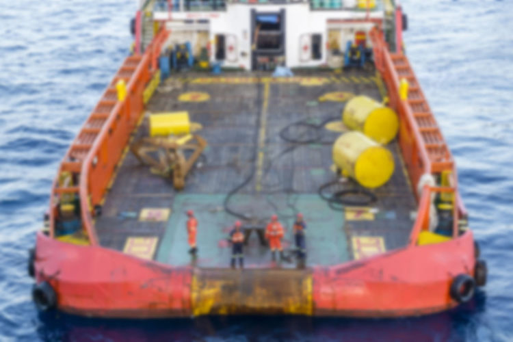 blurry image of anchor handling job Oil And Gas Industry Rigging Deck Oil Field Work Able Bodied Seamen Anchor Buoy Tug Boat Stern Vessel Nautical Blur Blurry Background Anchor Handling Offshore Offshore Life Water Nautical Vessel Sea Wave Ship Boat