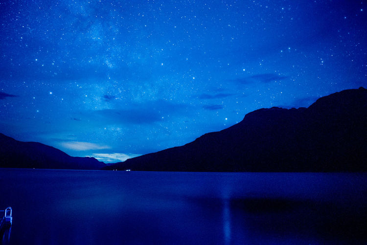 Starry Night Over Slocan Lake Nightphotography Astronomy Beauty In Nature Blue British Columbia Galaxy Idyllic Lake Mountain Nature Night No People Outdoors Scenics - Nature Silhouette Sky Space Space And Astronomy Star Star - Space Star Field Stars Tranquil Scene Tranquility Water