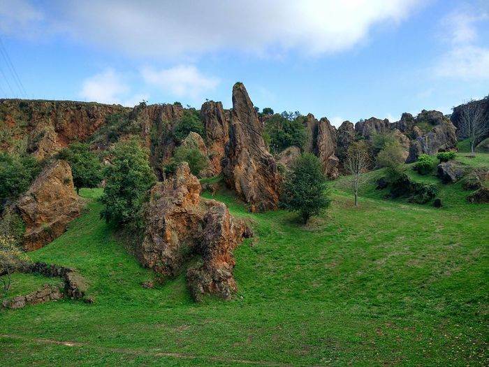 Scenic view of landscape with rock formation against sky