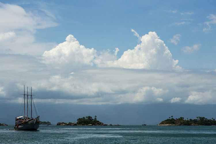 Water Scenics Tranquility Beauty In Nature Cloudscape Tranquil Scene Sky Dramatic Sky Non-urban Scene Cloudy Waterfront Nature Day Cloud Vacations Sea Calm Blue Majestic Cloud - Sky Paradise Paraty - RJ