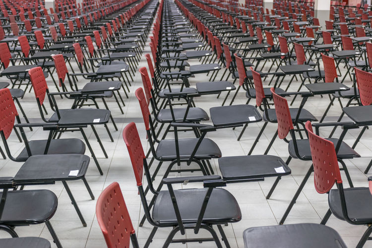 Absence Anticipation Auditorium Chair Day Empty Folding Chair In A Row Indoors  Large Group Of Objects Lecture Hall No People Red Seat Seminar Stadium Table
