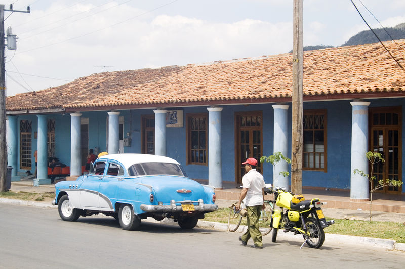 Blue Building Exterior Built Structure Car Cuba Day Land Vehicle Mode Of Transport Old Car One Person Outdoors Pinar Del Rio Tourist Destination Transportation Viñales