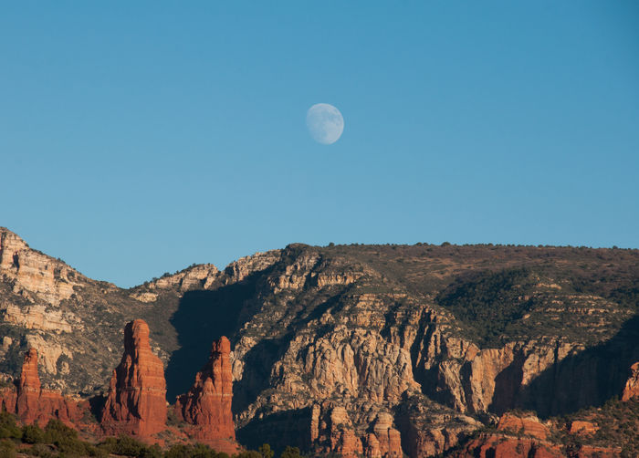 Yesterday's moon Astronomy Beauty In Nature Day Landscape Moon Mountain Nature No People Outdoors Red Rocks  Rock Formation Sky Blue Sky Travel Destinations Clear Sky The Great Outdoors - 2017 EyeEm Awards Neighborhood Map