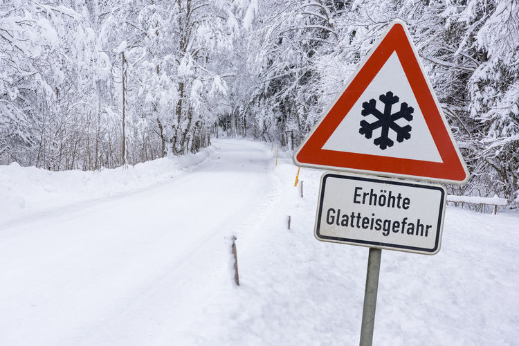 Information sign on snow covered road