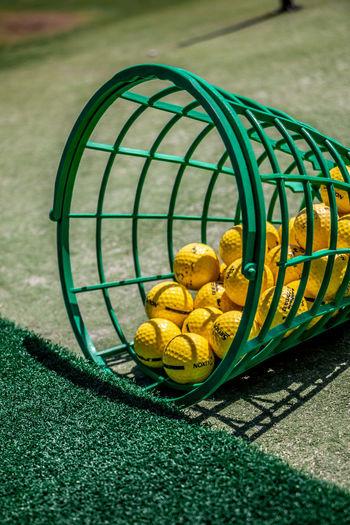 High angle view of yellow ball on grass