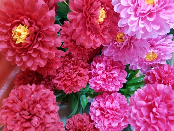 Top view of red and pink artificial flower blooming Decoration Artificial Pollen Petal Top View Red Pink Flower Head Flower Peony  Petal Flower Market Close-up Plant Blooming