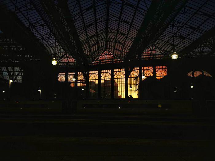 Low angle view of illuminated railroad station at night