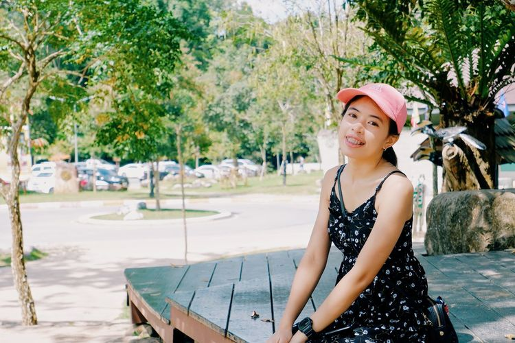 Portrait of smiling young woman in park