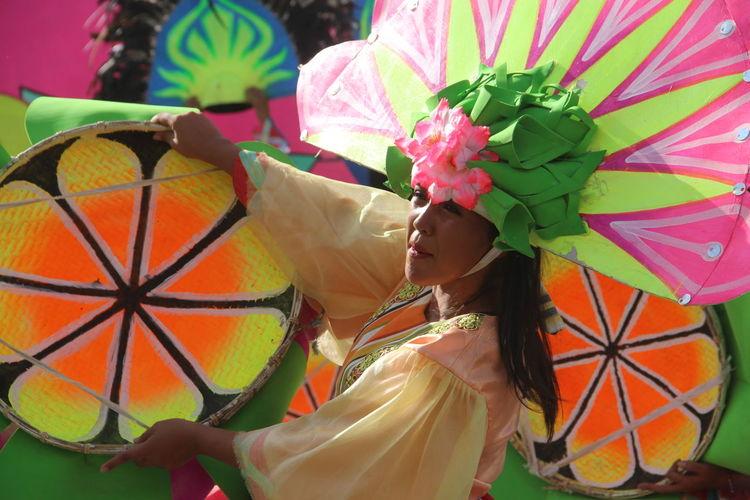 Woman holding multi colored umbrella