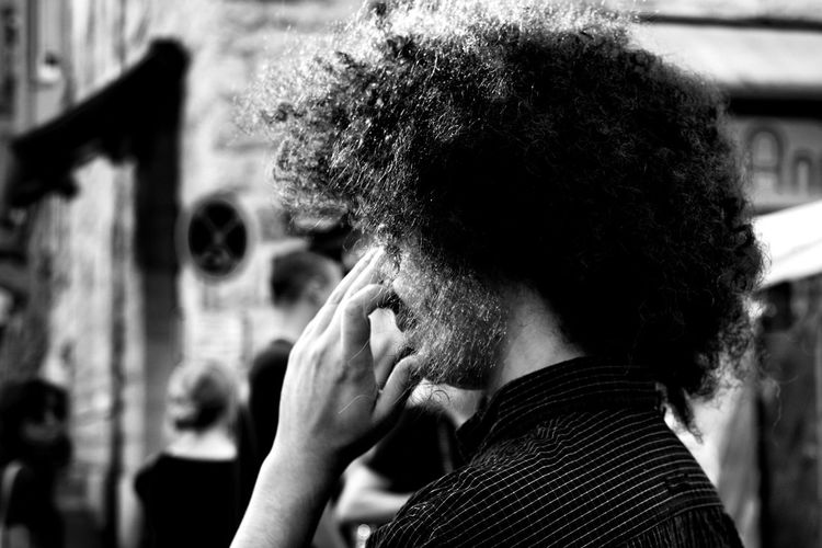 Side View Of Man With Afro Hairstyle