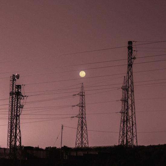 Electricity  Technology Cable Sky Electricity Pylon Connection Power Line  Fuel And Power Generation Power Supply Sunset Nature No People Low Angle View Moon Silhouette Dusk Architecture Built Structure Lighting Equipment Outdoors Full Moon Global Communications