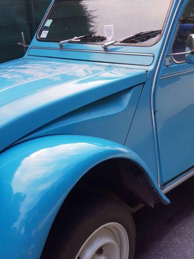 Reflection of blue sky on car