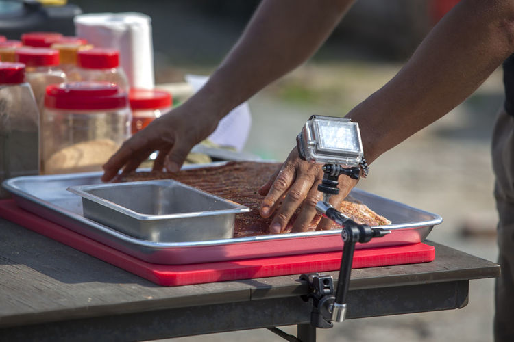 Accuracy Barbeque Bucket Chef Close-up Cooking Cropped Day Equipment Focus On Foreground Food Guitar Leisure Activity Lifestyles Machinery Outdoors Part Of Pork Rub Selective Focus Skill  Taking Photos Work Tool