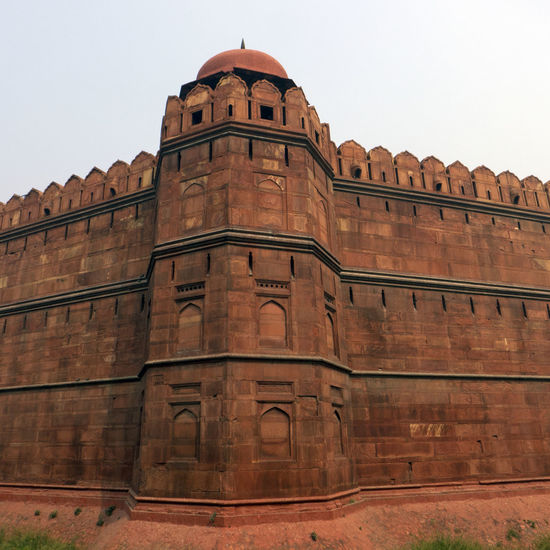 The Red Fort, Lal Qila in Delhi, India Brick Wall Castle Delhi India Lal Qila Wall Architecture Building Exterior Built Structure Famous Place Fassade History Low Angle View Medieval Palace Red Fort Travel Destinations Unesco World Heritage