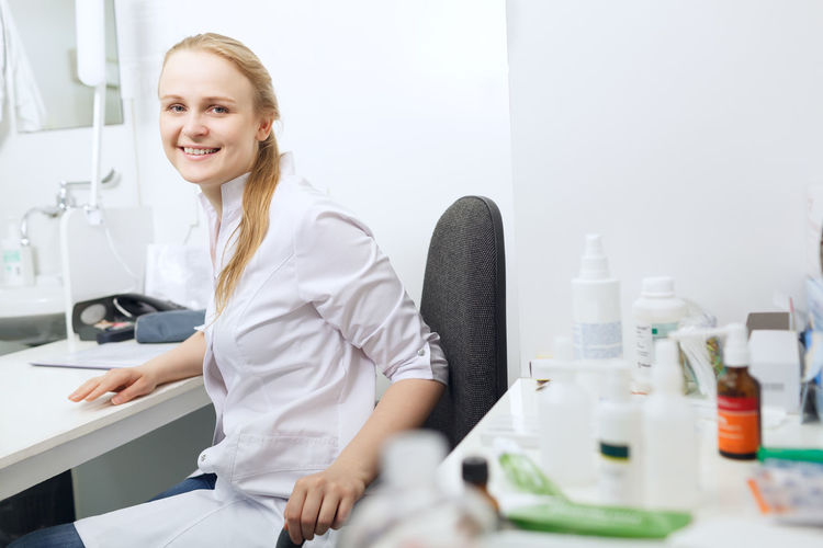 Portrait of confident female doctor at clinic