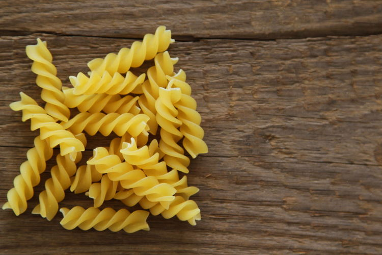 Fusilli Close-up Food Food And Drink Freshness Fusilli Pasta Healthy Eating Italian Food No People Pasta Raw Food Table Wood - Material Wooden Background Yellow
